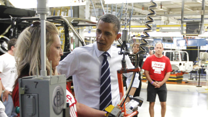 FILE - In this Friday, June 3, 2011 file photo, President Barack Obama tours Chrysler Group's Toledo Supplier Park in Toledo, Ohio. Will voters in Ohio focus on the revitalized auto industry and unemployment below the U.S. average and regard Obama as the architect of a hopeful but not yet robust economy? Or will they see government as an obstacle, hundreds of thousands of people still out of work and look to Mitt Romney for the answers? (AP Photo/Charles Dharapak, File)
