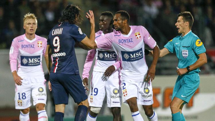 Cavani of Paris St-Germain clashes with players of Evian Thonon Gaillard during their French Ligue 1 soccer match in Annecy