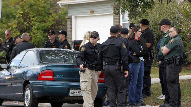Police gather after canvassing a neighborhood looking for clues in the search for ten-year-old Jessica Ridgeway near her home in Westminster, Colo., on Wednesday, Oct. 10, 2012. The youngster has been missing since she left her home Friday morning on her way to school. (AP Photo/Ed Andrieski)