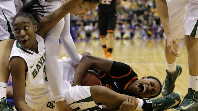 Baylor guard Jordan Madden, bottom left, looks toward an official waiting for a call as Oklahoma State forward Toni Young (15) scrambles on the floor for a turnover by Baylor in the second half of an NCAA college basketball game in the Big 12 women's tournament Sunday, March 10, 2013, in Dallas. Baylor's Brittney Griner, top left, and Alexis Prince, top right, watch in the 77-69 Baylor win.   (AP Photo/Tony Gutierrez)