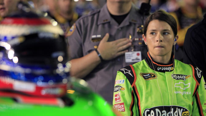 Danica Patrick stands by her car before the NASCAR Daytona 500 auto race at Daytona International Speedway in Daytona Beach, Fla., Monday, Feb. 27, 2012. (AP Photo/John Raoux)