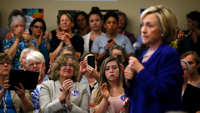 Attendees applaud remarks by U.S. Democratic presidential candidate Hillary Clinton at a campaign event in Iowa City