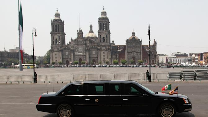 The presidential limousine with President Barack Obama inside, drives past the Metropolitan Cathedral in Mexico City's main plaza, the Zocalo, Thursday, May 2, 2013. Seeking to put a new spin on a long-standing partnership, Obama is promoting jobs and trade - not drug wars or border security - as the driving force behind the U.S.-Mexico relationship. (AP Photo/Marco Ugarte)