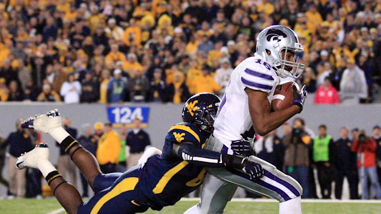 Kansas State's Tyler Lockett (16) is brought down by West Virginia's Karl Joseph during the second quarter of an NCAA college football game in Morgantown, W.Va., Saturday, Oct. 20, 2012. (AP Photo/Christopher Jackson)