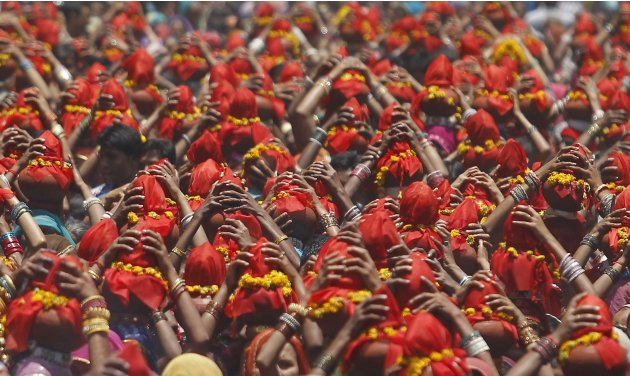 Hindu women carry Kalash during a religious procession locally known as Ganga Kalash Yatra in Ahmedabad
