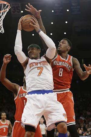 Milwaukee Bucks' Larry Sanders (8) defends against New York Knicks' Carmelo Anthony (7) during the first half of an NBA basketball game on Friday, April 5, 2013, in New York. (AP Photo/Frank Franklin II)