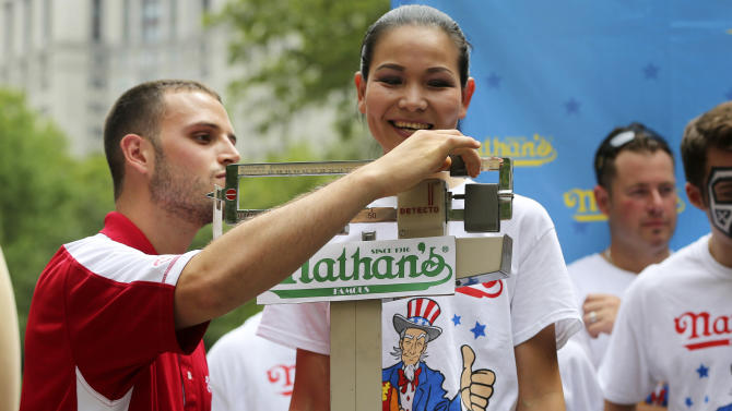 Sonya Thomas stands on the scale during official weigh-ins for the Nathan's Hot Dog Eating Contest