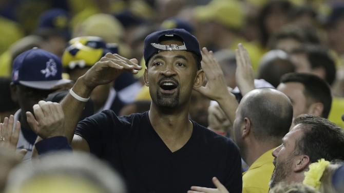 Former Michigan player Juwan Howard walks near the floor before the first half of the NCAA Final Four tournament college basketball championship game between Louisville and Michigan, Monday, April 8, 2013, in Atlanta. (AP Photo/Charlie Neibergall)