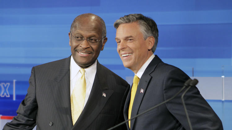 Republican presidential candidates businessman Herman Cain, left, and former Utah Gov. Jon Huntsman, get together prior to a debate Thursday, Sept. 22, 2011, in Orlando, Fla. (AP Photo/John Raoux)