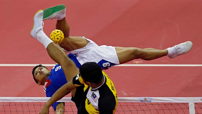 Indonesia's Nofrizal strikes the ball against Malaysia's Zamree Bin Mohd Dahan during their men's team sepaktakraw game at the 17th Asian Games in Incheon