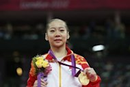 Gold medalist China&#39;s gymnast Deng Linlin poses on the podium of the women&#39;s beam competition of the artistic gymnastics event of the London Olympic Games at the 02 North Greenwich Arena in London