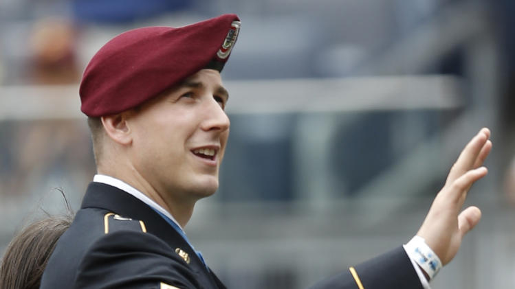 Medal of Honor recipient and former Army Staff Sgt. Ryan Pitts waves to fans during a pregame ceremony before the Texas Rangers faced the New York Yankees in a baseball game at Yankee Stadium in New York, Thursday, July 24, 2014. (AP Photo)