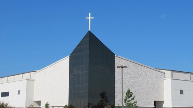 Victory Christian Center is shown on Wednesday, Sept. 19, 2012 in Tulsa, Okla. Five employees at the center face criminal charges for waiting more than two weeks to report the alleged rape of a 13-year-old girl on the south Tulsa campus. (AP Photo/Justin Juozapavicius)
