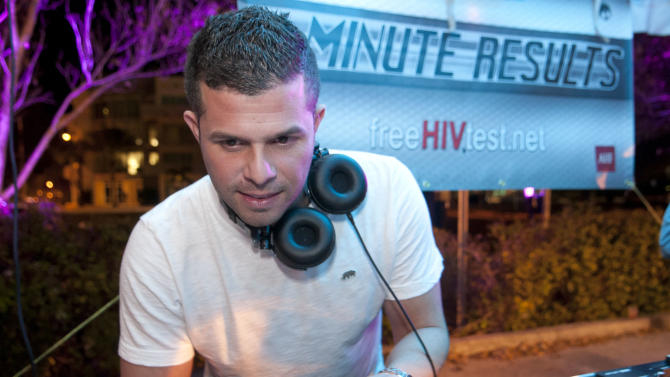 IMAGE DISTRIBUTED FOR AIDS HEALTHCARE FOUNDATION - Y100 DJ Chris Cruz performs at the Wilton Manors Out of the Closet (OTC) Block Party & Insti-Test Launch Marking the 5th anniversary of Wilton Manors OTC in Wilton Manors, Fla. on Saturday, Feb. 2, 2013 at the Hagan Park/City Hall parking lot in Wilton Manors, Fla. (Mitchell Zachs/AP Images for AIDS Healthcare Foundation)