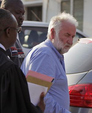 Loik Le Floch-Prigent, the former chief executive officer of the French oil corporation Elf arrives outside a court in Lome, Togo, Monday, Sept. 17, 2012. Loik Le Floch-Prigent, the former chief executive officer of the French oil corporation Elf, was extradited to Togo from Ivory Coast and will soon appear before a High Court judge here on charges of abetment of crime to defraud an Emirati businessman. (AP Photo/Erick Kaglan)