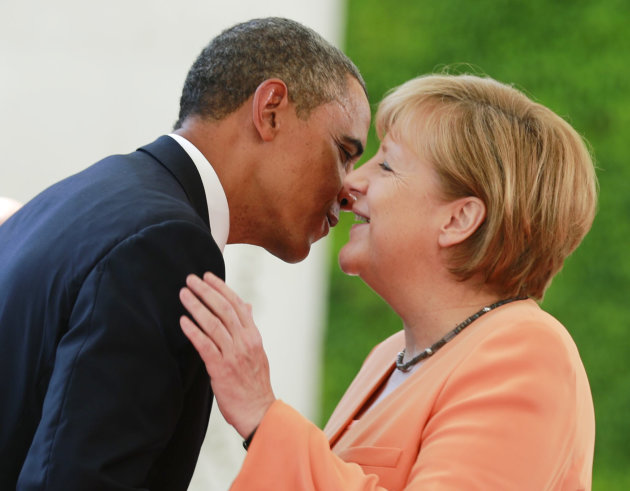 U.S. President Obama embraces German Chancellor Merkel outside the Chancellery in Berlin