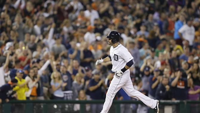 Detroit Tigers' J.D. Martinez rounds the bases after his two-run home run during the eighth inning of a baseball game against the Pittsburgh Pirates, Tuesday, June 30, 2015, in Detroit. (AP Photo/Carlos Osorio)