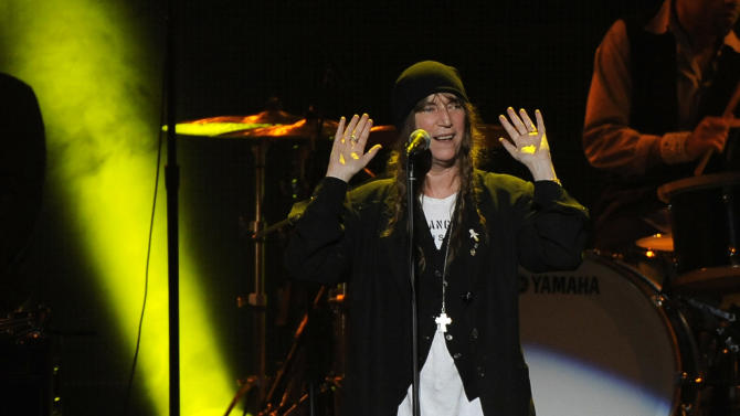 Patti Smith performs at the MusiCares Person of the Year tribute honoring Bruce Springsteen at the Los Angeles Convention Center on Friday Feb. 8, 2013, in Los Angeles. (Photo by Chris Pizzello/Invision/AP)