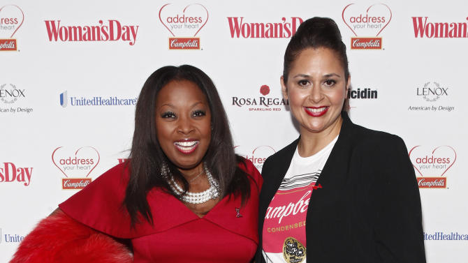 "IMAGE DISTRIBUTED FOR CAMPBELL SOUP COMPANY - Television personality Star Jones, left, and fan favorite and finalist on Bravo's ""Top Chef All-Stars,"" Chef Antonia Lofaso walk the red carpet at the Woman's Day Red Dress Awards on Tuesday, Feb. 12, 2013, in New York City. The event was in support of the American Heart Association's Go Red for Women movement. For more information, visit AddressYourHeart.com. (Brian Ach/AP Images for Campbell Soup Company)"