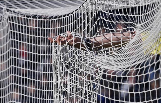 French referee Rainville checks the net at the Chaban Delmas Stadium in Bordeaux just before the French Ligue 1 match between Girondins Bordeaux and Lille