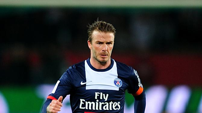 Beckham runs with the ball during PSG's match against Brest. (Getty)