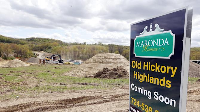 In this Monday, May 6, 2013 photo, construction is underway on the infrastructure of a multi-acre housing development in Zelienople, Pa. The Commerce Department reports the pace at which builders broke ground on homes in May later Tuesday June 18, 2013. (AP Photo/Keith Srakocic)