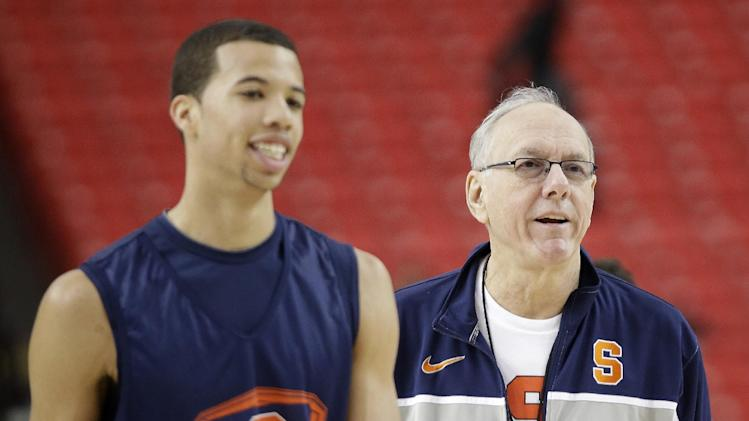 Syracuse's Michael Carter-Williams walks on the court with Syracuse head coach Jim Boeheim during practice the NCAA Final Four tournament college basketball semifinal game against Michigan, Friday, April 5, 2013, in Atlanta. Syracuse plays Michigan in a semifinal game on Saturday. (AP Photo/David J. Phillip)