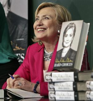 """HiIlary Rodham Clinton listens before signing a copy of her book, """"Hard Choices"""" on Tuesday June 10, 2014, at Barnes and Noble bookstore in New York. Clinton said Tuesday that she and former President Bill Clinton """"fully appreciate how hard life is for so many Americans,"""" seeking to refine remarks she made about the pair being broke when they left the White House while on a high-profile media tour for a new book. (AP Photo/Bebeto Matthews)"""