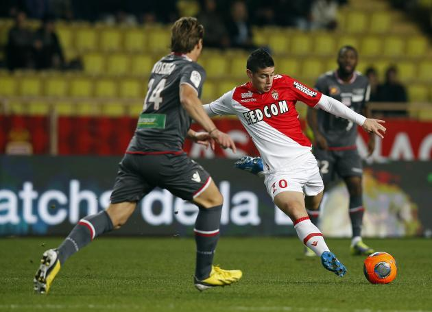 AS Monaco's James Rodrigues challenges Ajaccio's Mehdi Mostefa during their French Ligue 1 soccer match at Louis II stadium