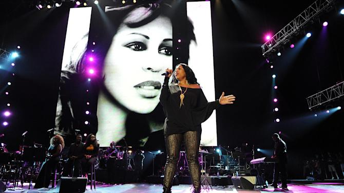 "FILE - In this July 8, 2012 file photo, Nicci Gilbert performs a tribute to Whitney Houston at the Essence Music Festival in New Orleans. TV reality show, ""R&B Divas,"" which airs Mondays at 10 p.m. EDT has an episode that shows the women's tribute performance from the 2012 Essence Music Festival honoring Whitney Houston, Etta James and others. (Photo by Cheryl Gerber/Invision/AP, File)"