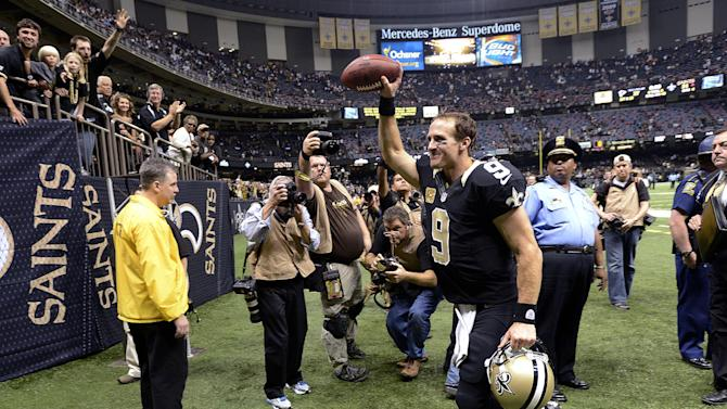 New Orleans Saints quarterback Drew Brees (9) runs off the field after their NFL football game against the Atlanta Falcons at the Mercedes-Benz Superdome in New Orleans, Sunday, Nov. 11, 2012. The Saints won 31-27. (AP Photo/Bill Feig)