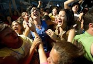 <p>Supporters of Miranda State governor Henrique Capriles Radonski celebrate his victory on December 16, 2012.</p>