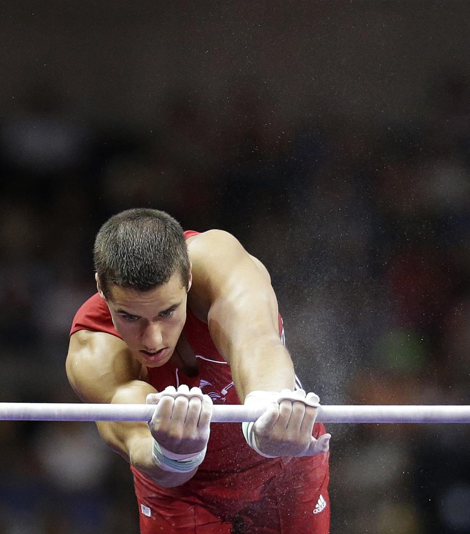 Jake Dalton performs on the horizontal bar during the final round of the men's Olympic gymnastics trials, Saturday, June 30, 2012, in San Jose, Calif. (AP Photo/Jae C. Hong)