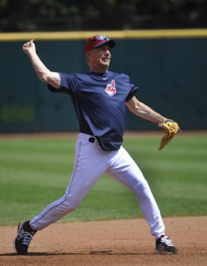 "Actor Kevin Costner makes a throw to first base while taking infield warm-ups with the Cleveland Indians before their game against the Minnesota Twins, in Cleveland, Sunday, June 23, 2013. Costner has been in Cleveland filming scenes for the movie ""Draft Day""(AP Photo/Phil Long)"