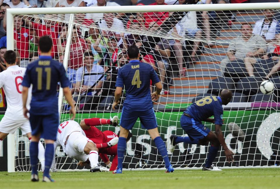 England's Joleon Lescott, third left,  scores a goal  during the Euro 2012 soccer championship Group D match between France and England in Donetsk, Ukraine, Monday, June 11, 2012. (AP Photo/Manu Fernandez)
