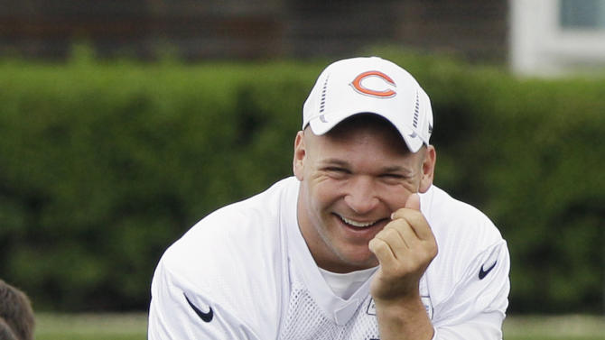 FILE - In this May 30, 2012 file photo, Chicago Bears linebacker Brian Urlacher watches teammates practice during an NFL football practice in Lake Forest, Ill. Urlacher says he's retiring after spending 13 seasons with the Bears. The eight-time Pro Bowler announced his retirement through social media accounts Wednesday, May 22, 2013. (AP Photo/Nam Y. Huh, File)