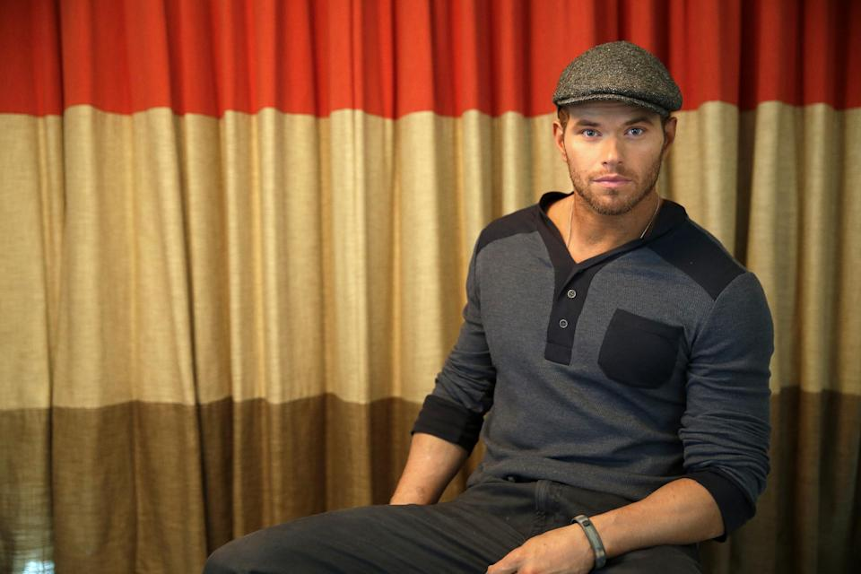 Actor-designer Kellan Lutz poses for a portrait to promote his clothing line Abbot + Main's pre-spring 2014 collection at the Mandalay Bay Hotel on Monday, Aug. 19, 2013 in Las Vegas. (Photo by Isaac Brekken/Invision/AP)