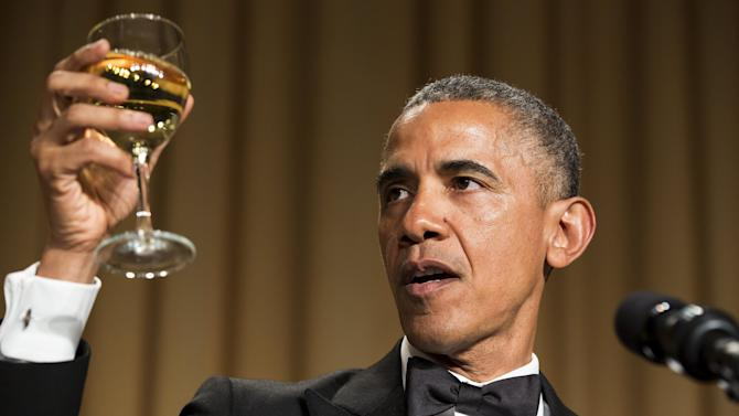 U.S. President Barack Obama makes a toast at the 2015 White House Correspondents' Association Dinner
