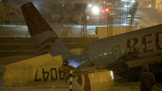 Wreckage of a plane which careered off the runway at Vnukovo Airport in Moscow, Saturday, Dec. 29, 2012. A Tu-204 aircraft belonging to Russian airline Red Wings careered off the runway at Russia's third-busiest airport on Saturday, broke into pieces and caught fire, killing several people. (AP Photo/Ivan Sekretarev)