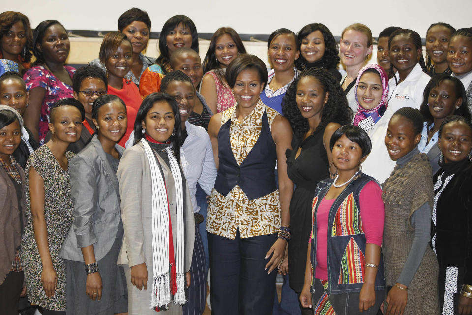 First lady Michelle Obama poses for a photo with young women leaders during her visit to the Apartheid Museum in Johannesburg, South Africa, Tuesday, June 21, 2011. (AP Photo/Charles Dharapak, Pool)
