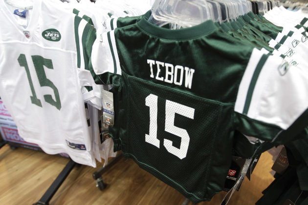 FILE - In this March 26, 2012, file photo, Reebok brand New York Jets football jerseys with the name and number of their new quarterback Tim Tebow hang on display at a Modell's store in New York. Nike Inc. claims in a lawsuit on Wednesday, March 28, 2012, in U.S. District Court that Reebok International Ltd. has used Tebow's name on Jets-related apparel without permission since it was announced last week that Tebow was traded from the Denver Broncos to New York. The Tebow trade occurred just before Nike replaces Reebok on Sunday as the supplier of NFL team uniforms. (AP Photo/Mary Altaffer, File)