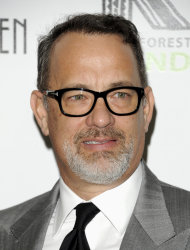 FILE - In this April 3, 2012 file photo, actor and producer Tom Hanks attends the Revlon Concert for the Rainforest Fund dinner and auction at The Pierre Hotel in New York. Beginning Thursday, many of the top digital outlets will for the first time band together to try an old TV tradition: the upfront. Over the next two weeks, YouTube, Yahoo, AOL, Hulu and others will hold their version of the annual pitch to advertisers to promote their programming slates. Yahoo has teamed with Tom Hanks for a highly-anticipated animated sci-fi series. (AP Photo/Evan Agostin, filei)