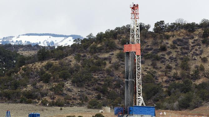 In this March 29, 2013 photo, a rig drills for natural gas which will eventually be released using hydraulic fracturing, or fracking, on leased private property outside Rifle, in western Colorado. Once drilling is completed, wells are fractured to allow the flow of gas from deposits typically more than a mile underground. (AP Photo/Brennan Linsley)