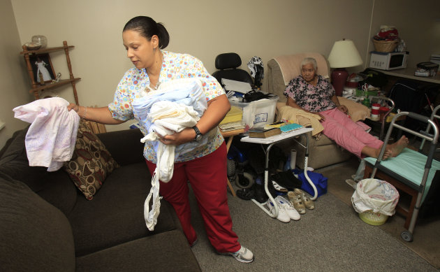 <p>               In this Aug. 1, 2012 photo, Taura Tate, left, a home care aide since 1999, folds laundry for Crell Johnson, 76, at Johnson's apartment, in Euclid, Ohio. For the past three years, she has spent four hours each weekday morning caring for Johnson, who is in her 70s and suffered a stroke and has diabetes. Tate cooks Johnson's oatmeal for breakfast, helps her shower and watches to make sure she takes the right medicine. (AP Photo/Tony Dejak)