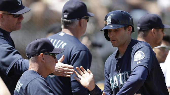 Ryan drives in three, Mariners top A's 5-3