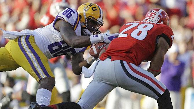 LSU wide receiver Kadron Boone (86) misses a pass as Georgia safety Tray Matthews (28) defends during the second half of an NCAA football game, Saturday, Sept. 28, 2013, in Athens, Ga