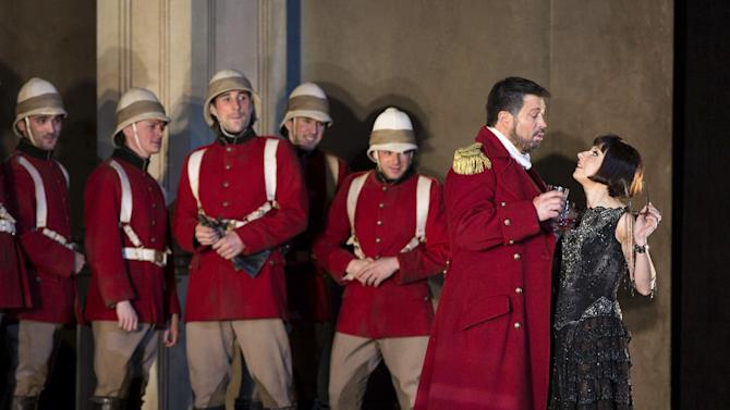 """In this March 26, 2013 photo provided by the Metropolitan Opera, Natalie Dessay as Cleopatra, right, and David Daniels as Julius Caesar, second from right, perform during a rehearsal of Handel's """"Giulio Cesare."""" (AP Photo/ Metropolitan Opera, Marty Sohl)"""