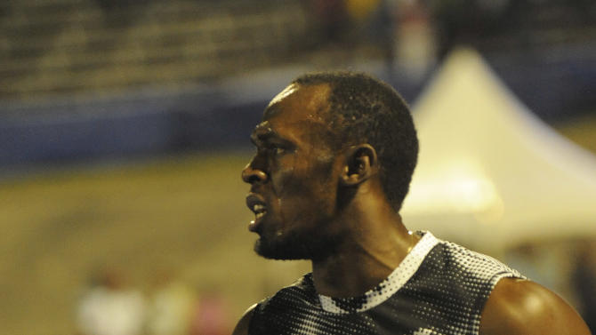 World-record holder Usain Bolt reacts after loosing to fellow countryman Yohan Blake the 100m final at Jamaica's Olympic trials in Kingston, Jamaica, Friday, June 29, 2012. Blake pulled a stunner finishing in 9.75 seconds to upset Bolt by 0.11 seconds. (AP Photo/Collin Reid)