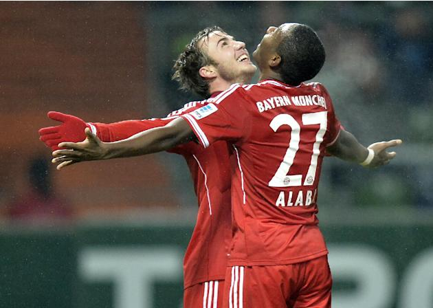 Bayern's scorer Mario Goetze, left, celebrates his goal with Bayern's David Alaba of Austria during the German Bundesliga soccer match between Werder Bremen and Bayern Munich in Bremen, German