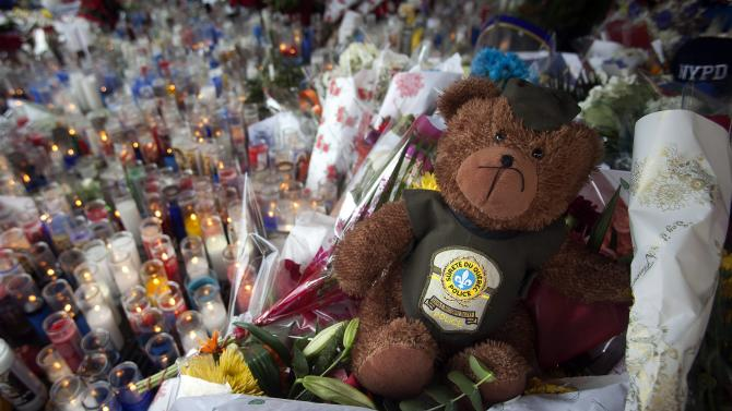 A teddy bear from the Quebec police is pictured at a makeshift memorial for two officers who were fatally shot, in the Brooklyn borough of New York